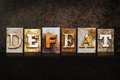 Defeat Letterpress Concept on Dark Background Stock Photos