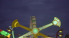 Amusement park ride on a cloudy early evening. 4K UHD. Stock Footage