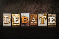Stock Photo of Debate Letterpress Concept on Dark Background