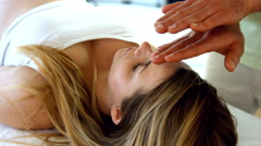 Therapist performing reiki on patient Stock Footage