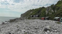 Church Ope Cove beach and huts, Isle of Portland, UK Stock Footage