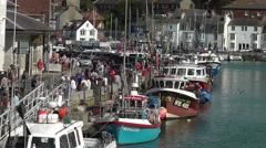 Tourists walking along the old harbour, Weymouth, Dorset, UK - stock footage