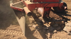 Mechanical Rake to Gather Stones of the the land Stock Footage