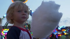 Stock Video Footage of Little Boy Holding Sweet Cotton Candy
