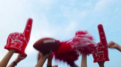 Tailgate: Group Of Fans Cheer Against Blue Sky Stock Footage