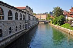 Ljubljanica river and Triple bridges in the background, Ljubljana, Slovenia Stock Photos