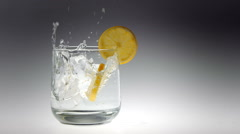 Slow Motion Ice Cubes Falling into Drink Stock Footage
