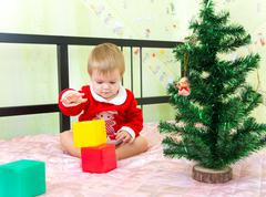 Talented little boy builds new year tower from plastic bricks Stock Photos