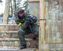 Extreme tactical military training with paintball guns - stock photo