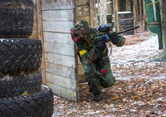 Extreme tactical military training in paintball club - stock photo