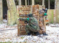 Two paintball shooters defending the fortification on snow Stock Photos
