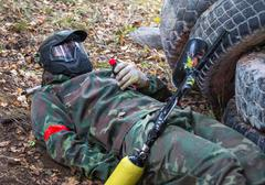 Lying soldier is going to blow up grenade on training - stock photo
