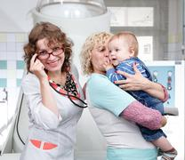 Mother, granny and little boy in hospital Stock Photos