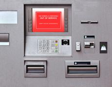 Banking machine with out of service sign on screen - stock photo
