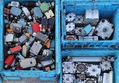 Old second hand small actuators pile sold on flea market - stock photo