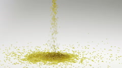 Slow Motion Millet Falling on White Surface Stock Footage
