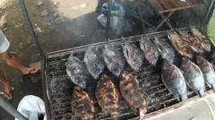Broiling tilapia fish overhead shot Stock Footage