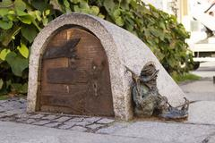 Dwarf guards the entrance of a small building Stock Photos