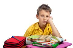 Boy with books looking bored. All on white background. Stock Photos