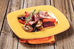 Accompaniment -Sauteed vegetables and slices of ham - stock photo