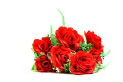 Artificial red roses on a white background Stock Photos