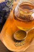 Lavender honey with bee pollen and honey comb Stock Photos