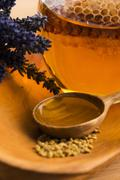 Stock Photo of Lavender honey with bee pollen and honey comb