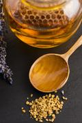 Lavender honey with bee pollen and honey comb - stock photo