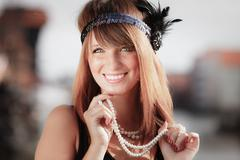 Flapper girl woman in1920s style portrait outdoor - stock photo