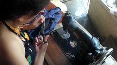 Dressmaker scissoring excess threads - stock footage