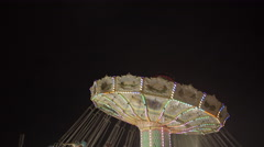 Chain swing ride at amusement park at night. 4K UHD. Stock Footage
