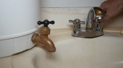Stock Video Footage of WATER RATIONING draught no water in faucet emergency water tank 3 of 4