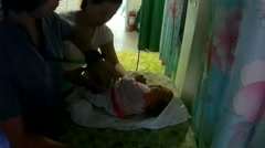 Nurse daubbing cotton with alcohol Stock Footage