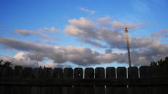 Backyard cloudscape over wood fence. Stock Footage