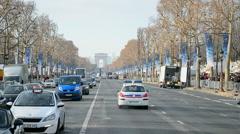 Car traffic near Arc de Triumphe (Arch of Triumph), Paris, France. - stock footage