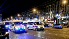 Police cars near Arch of Triumph of the Star, Avenue des Champs-Elysees, Paris. Stock Footage