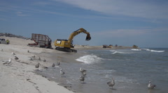 Wide excavation vehicles on beach. - stock footage