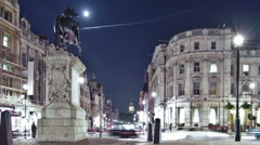 Time-lapse of traffic around Charing Cross in London at night. Cropped. Stock Footage