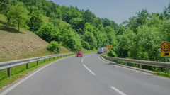 Small red zastava driving uphill Stock Footage