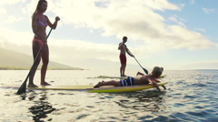 Happy Family Stand Up Paddling in Hawaii. - stock footage