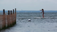 Young fit female on paddle board. - stock footage