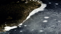 Oil bubbles and white foam in boiling water, close up Stock Footage