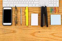 Office work supplies align with computer keyboard on desktop Stock Photos