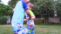 """Two young boys play """"ring around the rosie"""". - stock footage"""