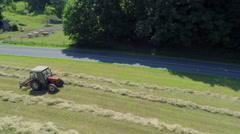 Vintage tractor is hay harvesting Stock Footage
