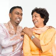 Indian family laughing - stock photo
