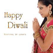Celebrating Diwali festival - stock photo