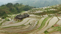 Village and Terraced Rice Field - zoom in Stock Footage