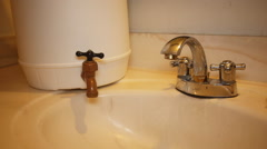 Stock Video Footage of WATER RATIONING draught no water in faucet emergency water tank 2 of 4