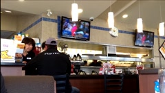 People ordering food inside Denny's restaurant Stock Footage